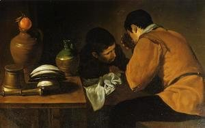 Two Young Men At A Table